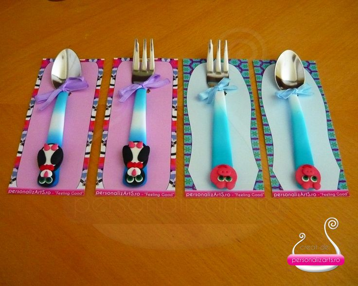 Polymer clay cutlery decorated with animal figurines