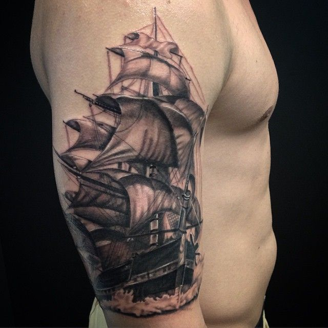 Incredible ship tattoo on man's arm.