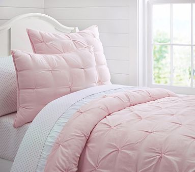 Audrey Quilted Bedding would be a soft touch against the hot pink decorative pillow