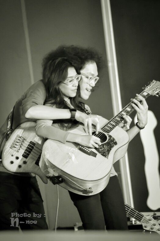 Playing guitar with couple