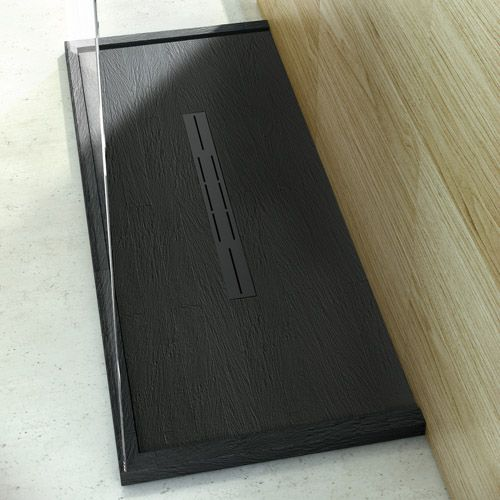 This Black slate tile effect ultra-low-profile designer shower tray is from the Privilege collection and has been made to measure for the client with 40mm up stands on 3 sides and a matching black painted central linear waste