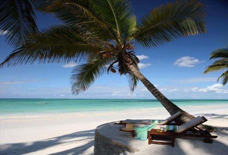 iGO travel | 4-star Zanzibar  Also known as 'spice island', The Sultan Sands Hotel situated on the very edge of the Indian Ocean only a few meters from a brilliant, white sand beach.  Situated on the very edge of the Indian Ocean only a few meters from a brilliant, white sand beach.