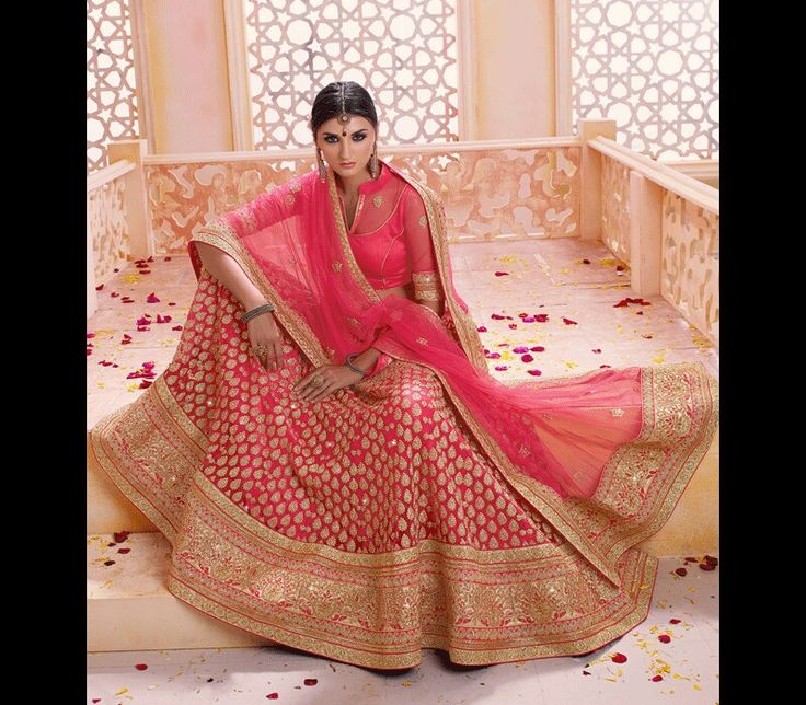 Pink Bridal Lehenga with golden thick border. Perfect color for modern day brides.