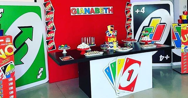 Here's a wide shot of the bold colorful set up inspired by the UNO game for a first birthday! Very original idea we loved to put together for our client! #elfspropshop #miamievents #miamiparties #props #miamiweddings #uno