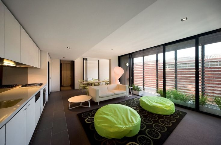 Apartments with White Kitchen Cabinet also Green Bean Bag on Carpet