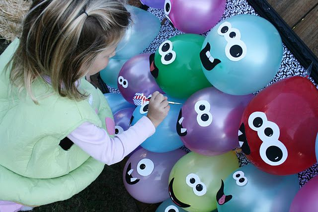 put candy in the ballon and blow up. cute idea