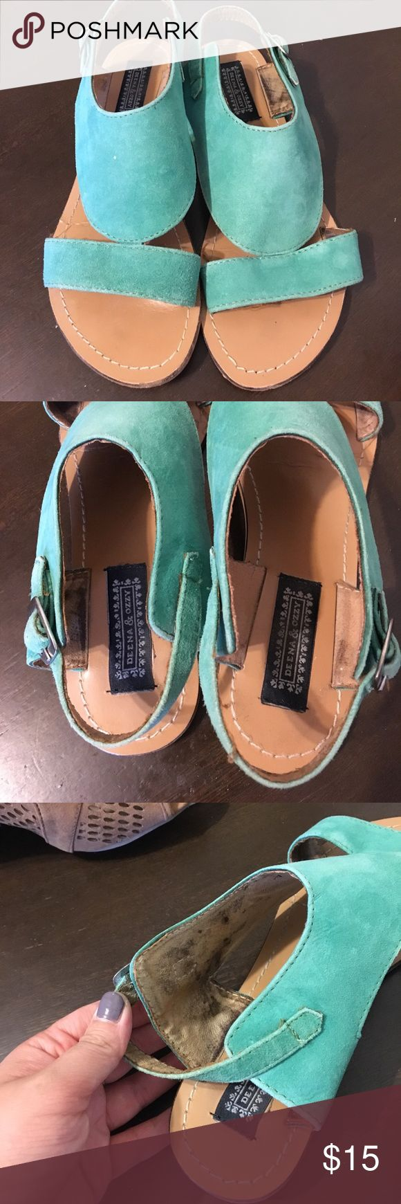 Deena and ozzy design oriented sandals Sandals worn six times. Super cute real/turquoise color. Their is some staining on the inside of the sandal but cannot be seen when worn. Deena & Ozzy Shoes Sandals