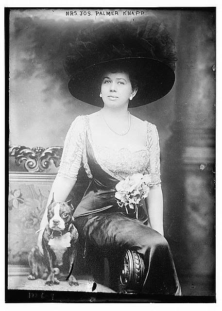 circa 1880: Mrs. Joseph Palmer Knapp and her Boston terrier.