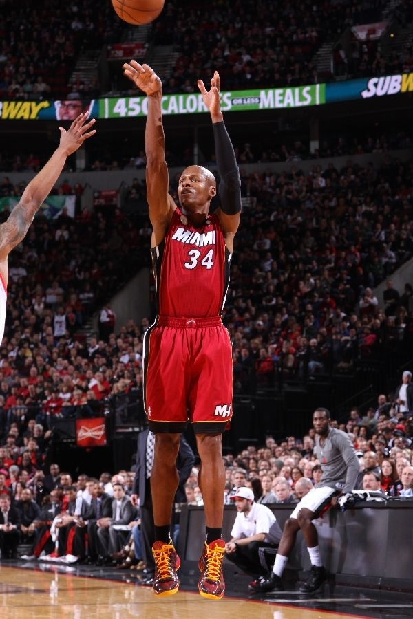 Ray Allen #34 of the Miami Heat shoots a three point shot against the Portland Trail Blazers