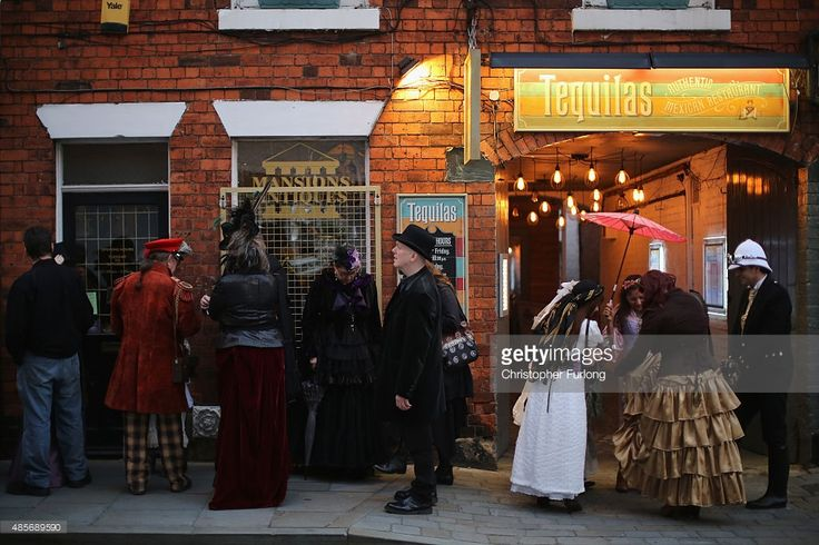 Steampunk enthusiasts queue for a fashion show as they attend the Asylum Steampunk festival on August 28, 2015 in Lincoln, England. The Asylum Steampunk Festival is the largest and longest running steampunk festival in the world and attracts participants
