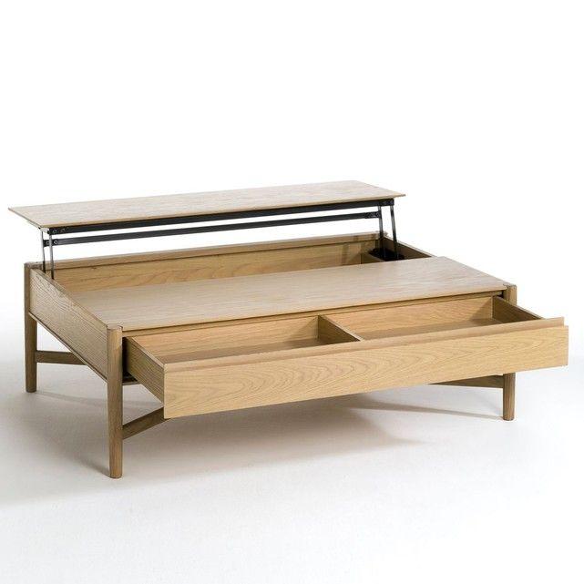 La table basse Irma. À la fois décorative et fonctionnelle, elle permet aussi de gagner de l'espace.Astucieuse, elle est équipée d'un demi-plateau relevable qui donne accès   à un grand espace de rangement, et d'un grand tiroir. Un plateau que   l'on déplie selon l'envie, idéal pour un ordinateur portable.    Caractéristiques :- En MDF plaqué chêne.- Pieds en chêne massif.- Finition laque polyuréthane- Tiroir à 2 compartiments.Dimensions :- L113 x H36 x P79 cm- Utiles du t...