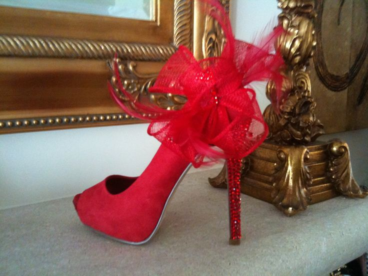 Hand embellished red peep toe courts with bow and feather detail   .. Find us on facebook