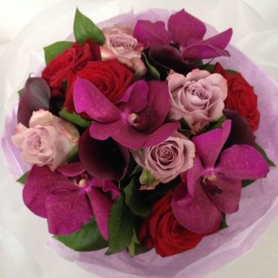 A beautiful, elegant bouquet with a blend of purple, pink, red, and deep burgundy flowers including Vanda Orchids.  Part of our Mothers Day 2016 Collection.