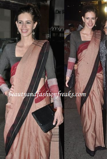 Kalki attended Prithvi Theatre Festival 2014 wearing a silk Fatherland sari with a long sleeved blouse. She wore her hair up and completed the look with Tod's clutch and a pair of long earrings. The look was quite event appropriate, she looked lovely.