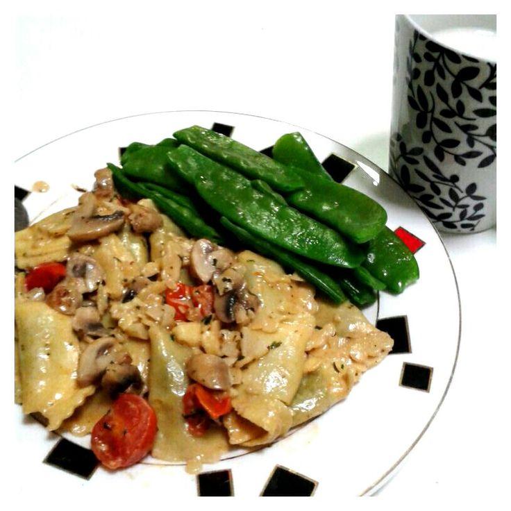 Spinach and ricotta agnolotti in mushroom and cherry tomato cream sauce