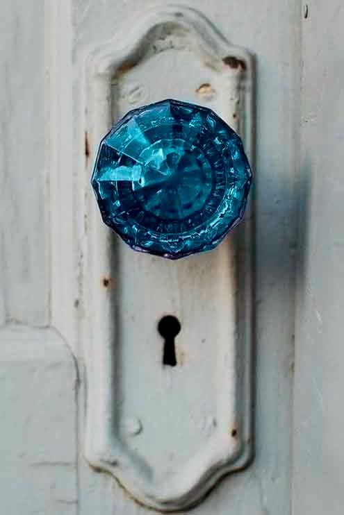 Blue glass door handle to enter the Frozen bathroom