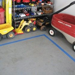 Tape off the garage floor so your parking spaces are always clear. You could even tape individual spaces for bikes, scooters, wagons, etc.