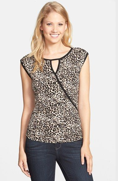 Free shipping and returns on Vince Camuto Leopard Print Faux Wrap Top (Regular & Petite) at Nordstrom.com. Slinky leopard spots cover a cap-sleeve jersey top topped with a peekaboo keyhole neckline outlined with solid trim.