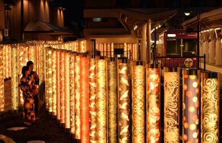 Poles decorated with kimono fabric patterns illuminate Arashiyama Station, Kyoto, Japan 京都友禅のLED