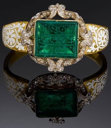 An inscribed Mughal emerald personal seal set in a diamond encrusted gold bangle and bearing the name of Major Alexander Hannay, an East India Company office.