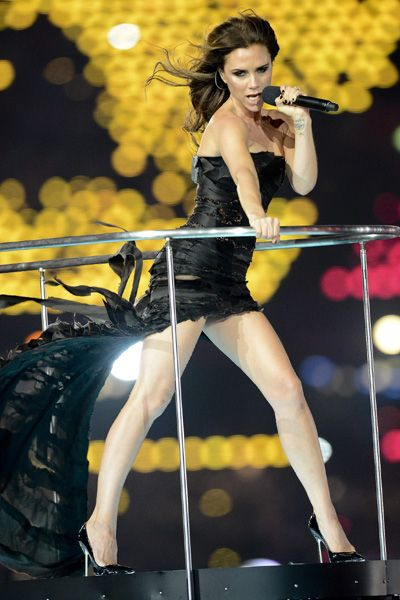 Victoria Beckham performs with the Spice Girls at Olympics Closing Ceremony