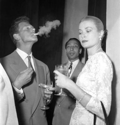 Grace Kelly with Jean-Pierre Aumont in Cannes.