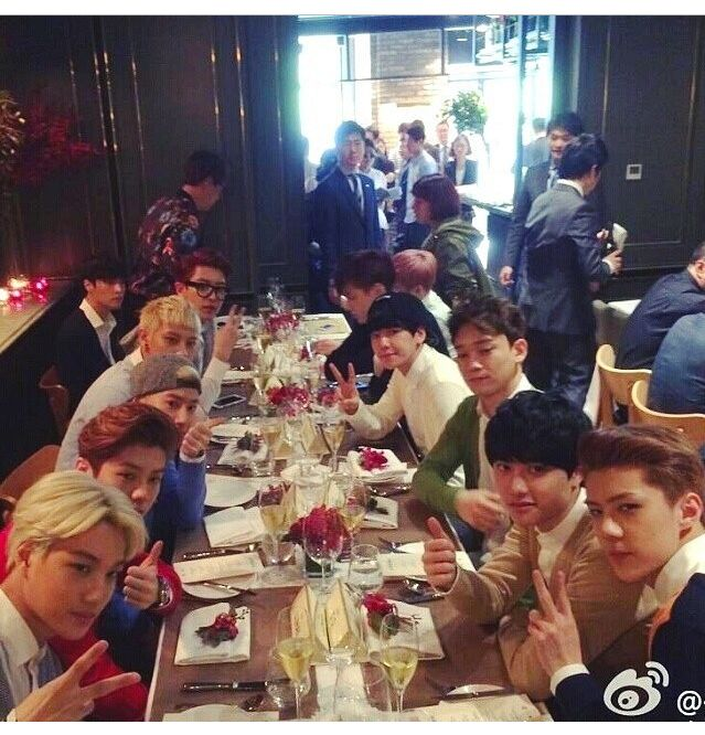 EXO eating at a restaurant