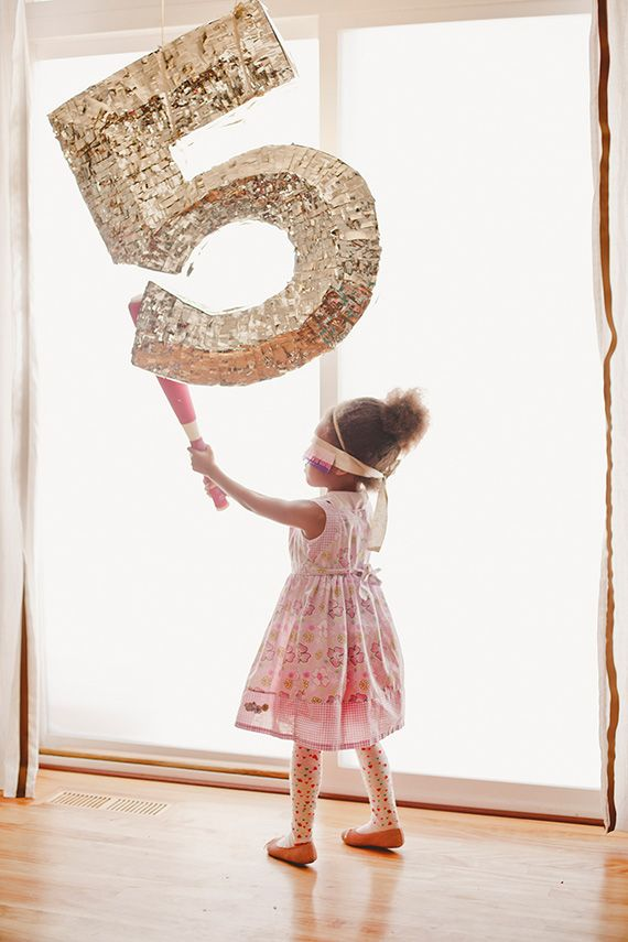 Use a number piñata for a kids' photo shoot
