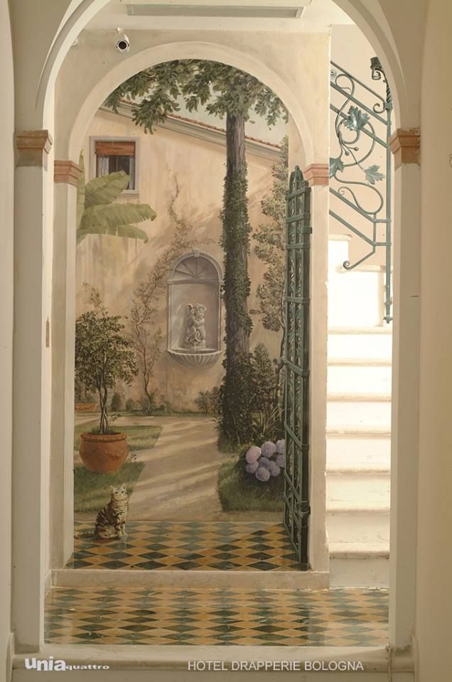 Trompe L'oeil mural featuring several archways leading to a patio.