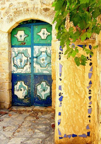 Interesting mosaic detail  on the approach to this colorful door.