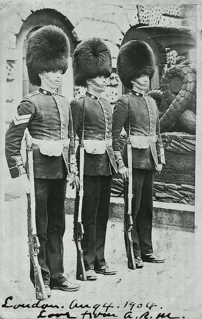 Horse Guards Parade London - This is a divided back postcard dated 1904 and shows three Coldstream Guardsmen on Horse Guards Parade with the Cadiz Memorial in the background. The Cadiz Memorial is a French mortar in the shape of a Chinese Dragon, it was given to the Prince Regent in 1812 by the Spanish Government to mark the lifting of the siege of Cadiz by the Duke of Wellington during the Peninsular war.