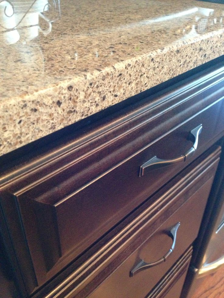 Quartz countertops with chocolate Schrock cabinets. I think they are the Raised Brinkman