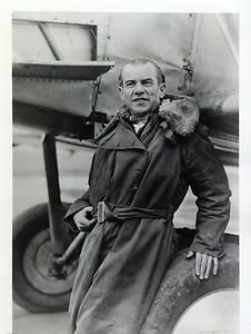 Airmail pilot Ira Biffle posing in winter flight gear leaning on his airplane in Chicago, Illinois. Biffle served as an airmail pilot for the Post Office Department from 1918-1919 and 1923-1927. In 1922, while serving as a flying instructor in Lincoln, Nebraska, Biffle taught flying to Charles Lindbergh.