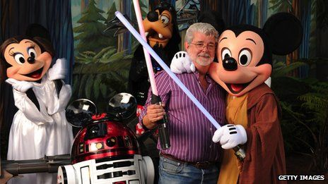 George Lucas poses with Star Wars inspired Disney characters in 2010...hmmm