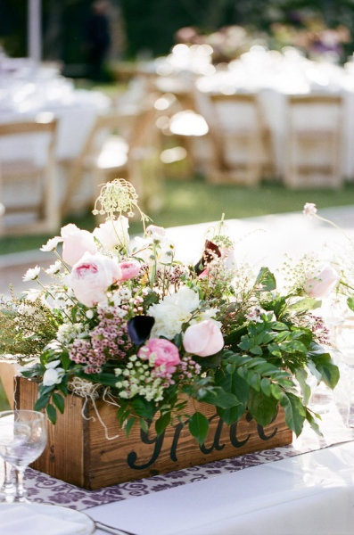floral centerpiece in a vintage wood box