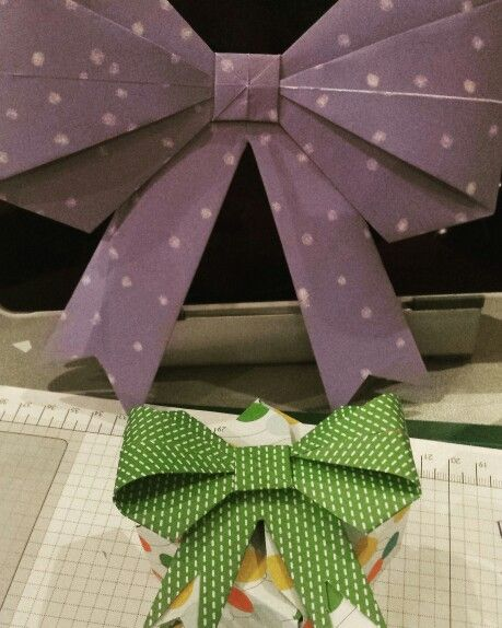 Cute paper bows 12x12 and 6x6 inch paper, found this video online: paper bow or click on the link.. Easy after the first one . [ Made by Mandy ]
