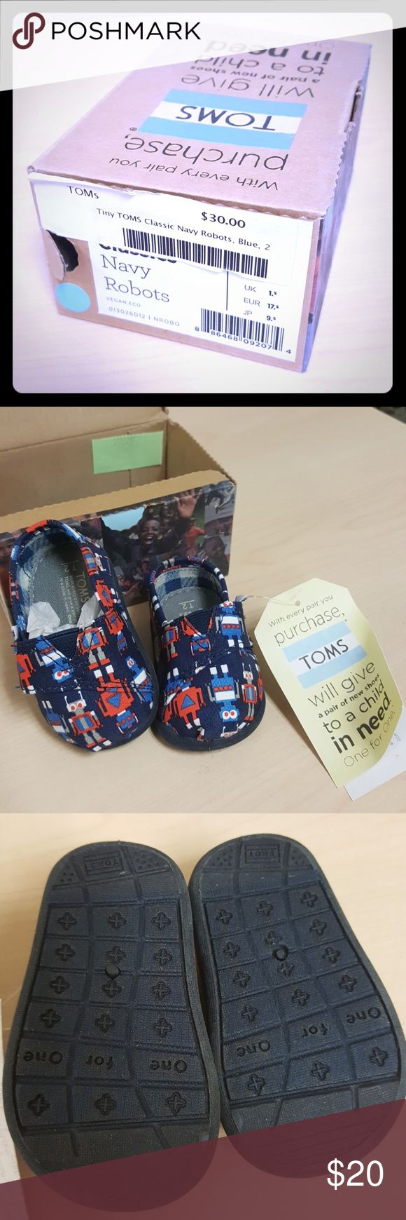 Tiny TOMS Navy Robots size 2 Tiny TOMS for a toddler in navy blue with robot print. Never used. NWT and box. Includes TOMS sticker and canvas bag. Toms Shoes Baby & Walker