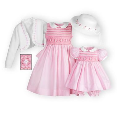 Classically hand-smocked pink sister dresses of cotton/poly piqué.  Pink and spring green embroidery adorns bodices.  White piqué collars. Button back closures. Knee lengths. Machine wash. Imported. A WOODEN SOLDIER exclusive.
