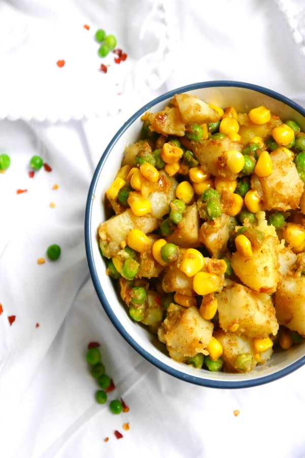 Easy Indian-Spiced Potatoes with corn and peas  Very easy and very quick Potatoes with corn, peas and Indian seasonings. You have yourself a taste of Indian food on your kitchen table just in few minutes.