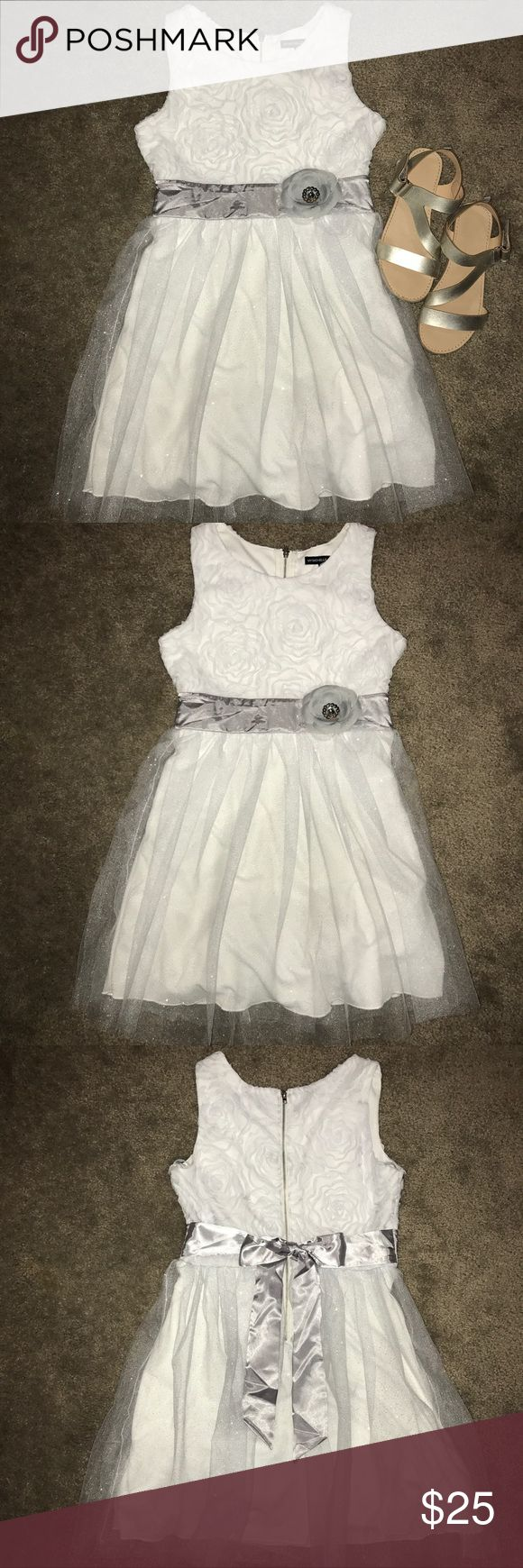 My Michelle Girls Dress With a sparkle mesh design and floral accent • Satin waistband • Crewneck • Back zipper & tie • Size: 10 • Worn once My Michelle Dresses