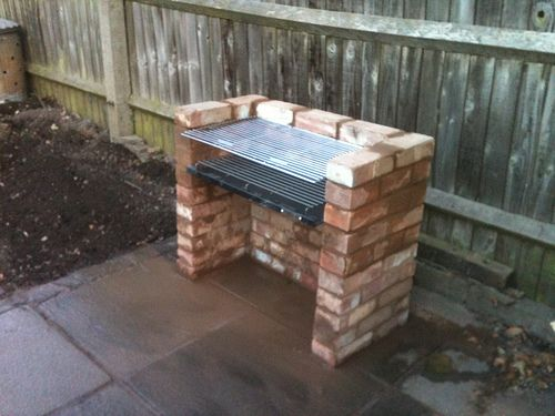 building a brick bbq brick in the backyard. Black Bedroom Furniture Sets. Home Design Ideas