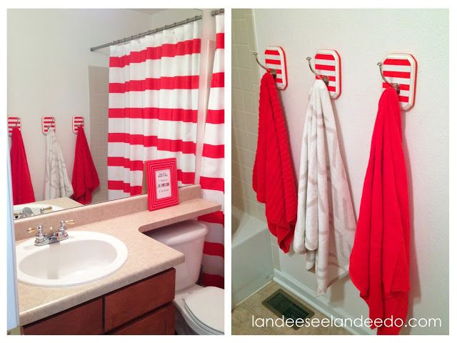 Such a cute kids bathroom! DIY Striped Towel Hooks, framed printable. landeeseeandlandeedo.com