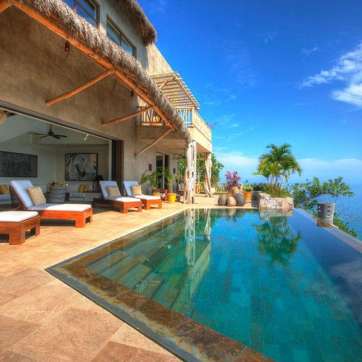 Casa la Perla Escondida,  with nothing but a crystal-clear infinity pool between you and the ocean this incredible Sayulita home is first-class in every respect. | TripWix Vacation Rentals