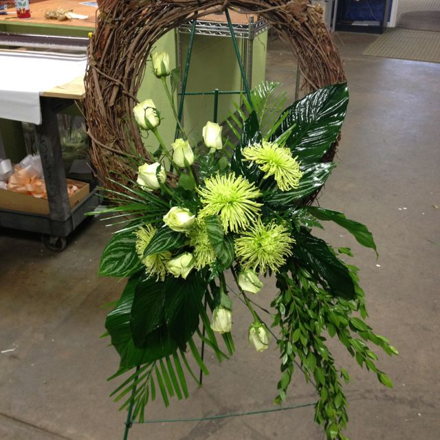 Funereal wreath with green roses