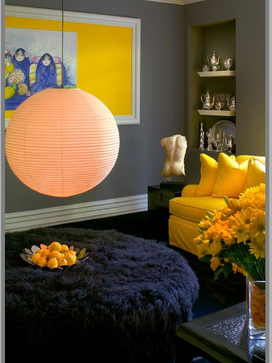 I'm loving dark gray walls with yellow couch... Dark and bright colors together work wonderfully together.