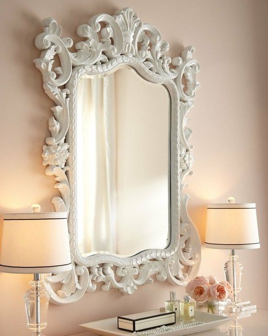 Cute home decor! Love this crisp white mirror and soft pink walls… The glass l