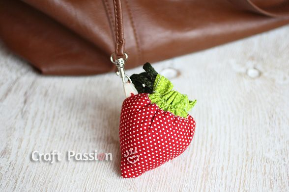 DIY Strawberry Reusable Grocery Bag - Sew a reusable grocery bag with a strawberry drawstring bag attached to it. Keep the grocery bag inside and pull to become a strawberry.