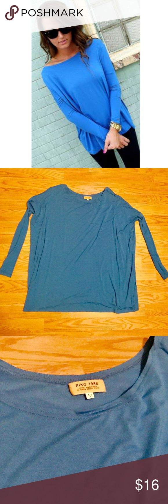 Piko blue long sleeve top Color true in 1st modeled photo. Lighting made last 2 photos appear different. Dry cleaned and good as new piko Tops Blouses