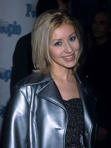 A pre-Dirrty 17-year-old Christina showed up to Teen People's first anniversary party with just a hint of lip gloss and pale blue eyeshadow to complement her short blonde hairstyle.