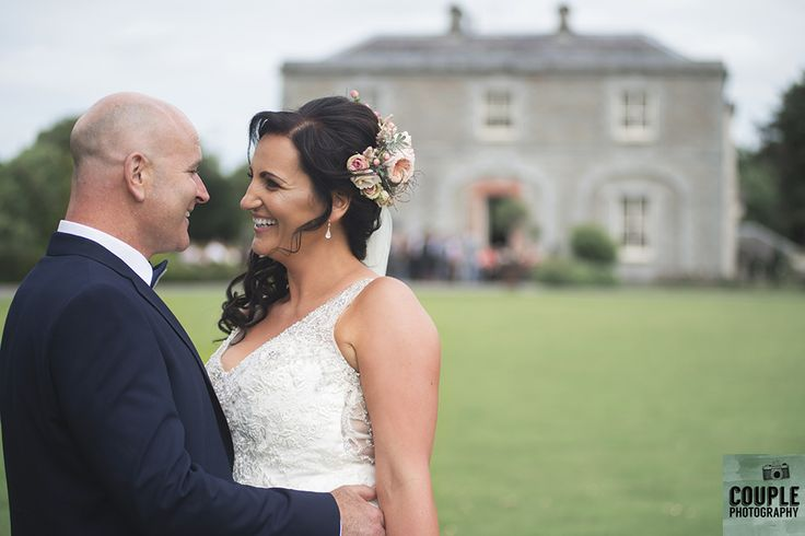 The happy newlyweds take a  stroll around the beautiful grounds. Weddings at Tankardstown House by Couple  Photography.
